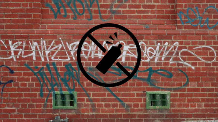 no graffiti sign on brick wall